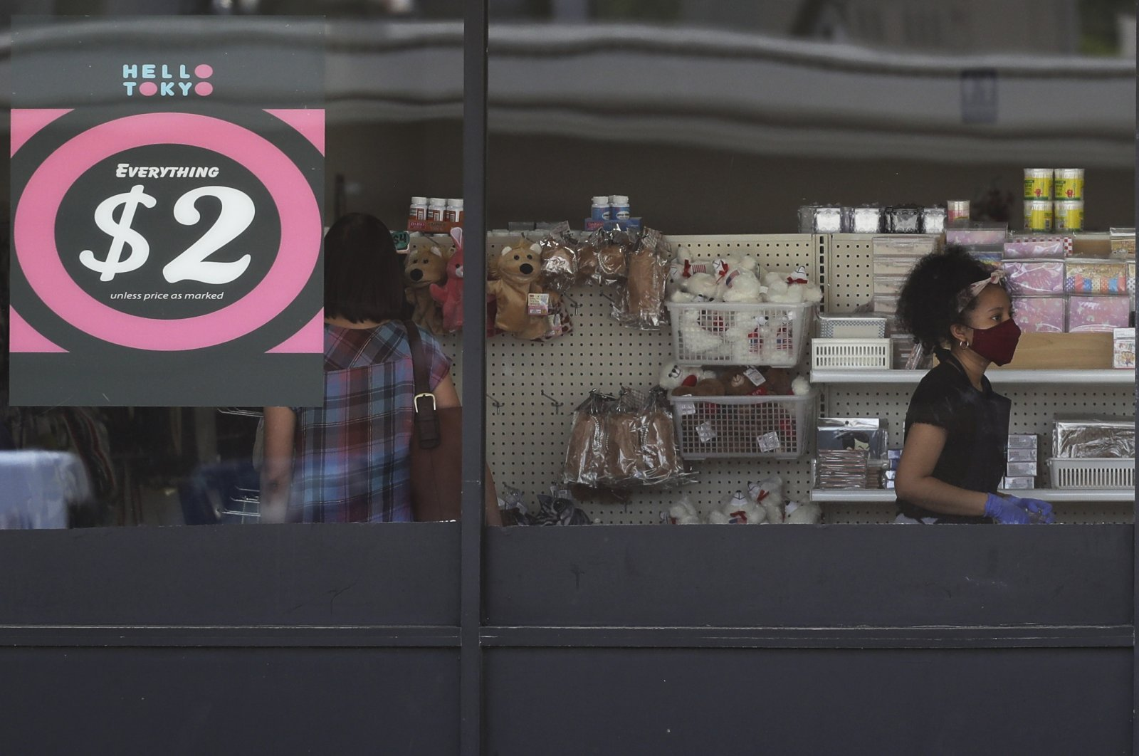 In this June 25, 2020, file photo, a price sign is displayed at a retail store as a store employee wears a mask while working in Niles, Ill. (AP Photo)
