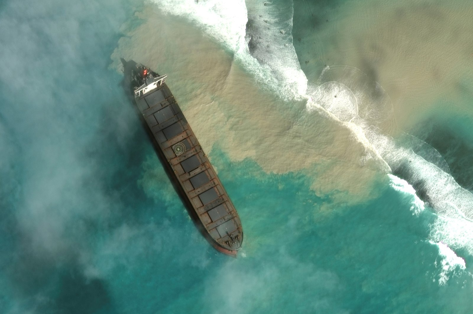 A satellite image shows MV Wakashio, a bulk carrier ship that ran aground off the southeast coast of Mauritius, August 1, 2020. (Maxar Technologies/via Reuters)