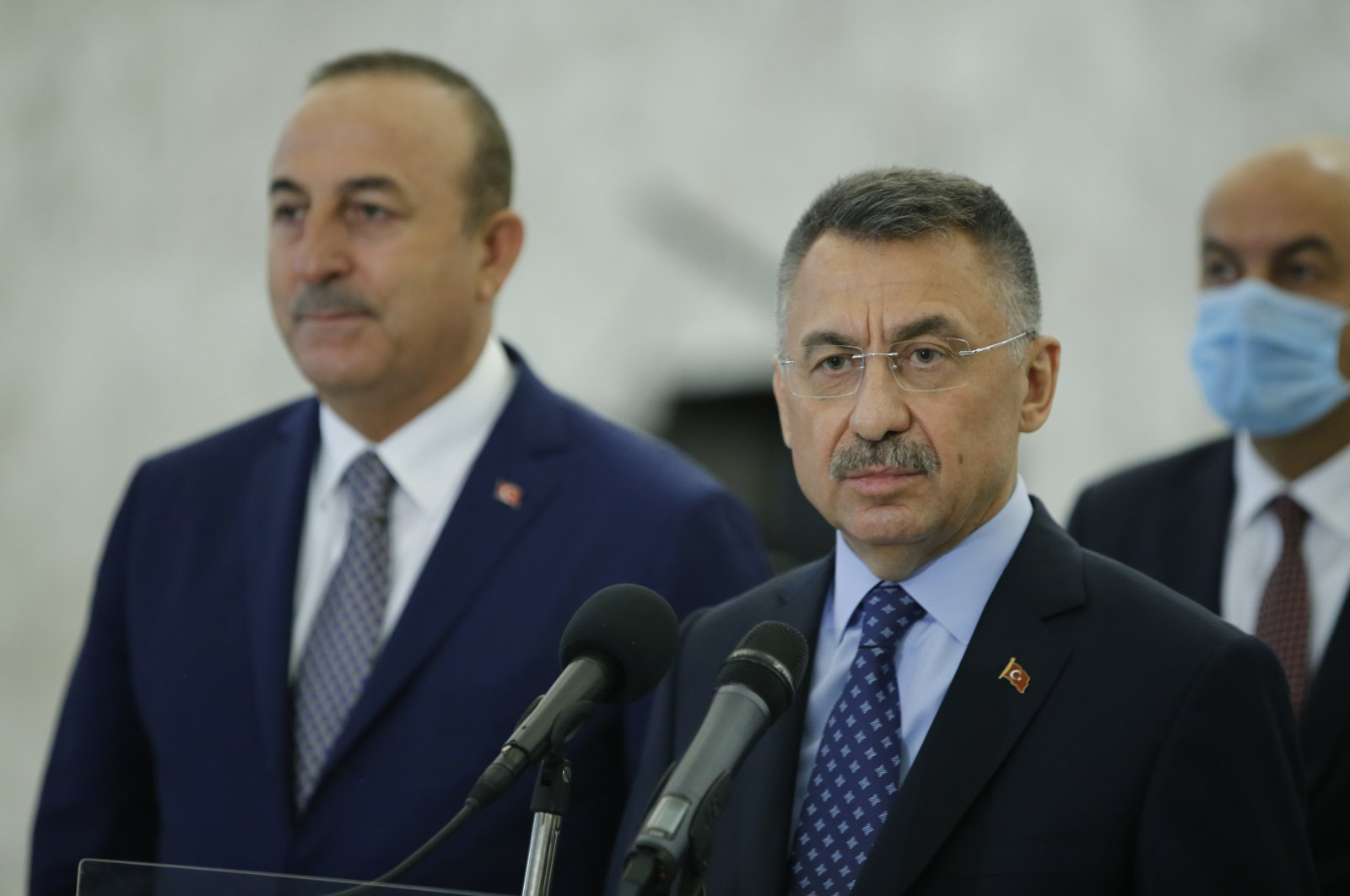 Vice President Fuat Oktay (R) and Foreign Minister Mevlüt Çavuşoğlu (L) take questions at a press conference after their meeting with Lebanese President Michel Aoun in Beirut, Lebanon on Aug. 8, 2020. (AA Photo)