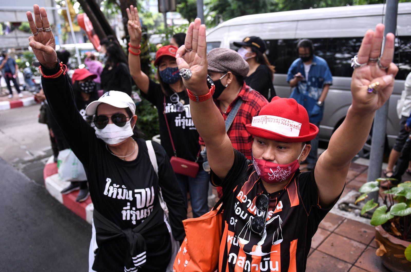Pro-democracy protesters stand outside the criminal court building demanding a representative be allowed inside where two leaders are still detained at the criminal court in Bangkok, Thailand on Aug. 8, 2020. (Reuters Photo)