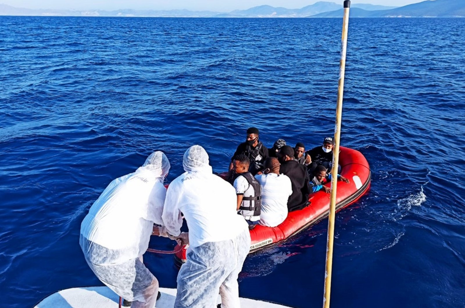 The Turkish coast guard rescued 9 asylum-seekers who were pushed back by the Greek side into Turkish waters off the Aegean coast, Bodrum district of southwestern province of Muğla, Turkey, August 8, 2020. (AA Photo )