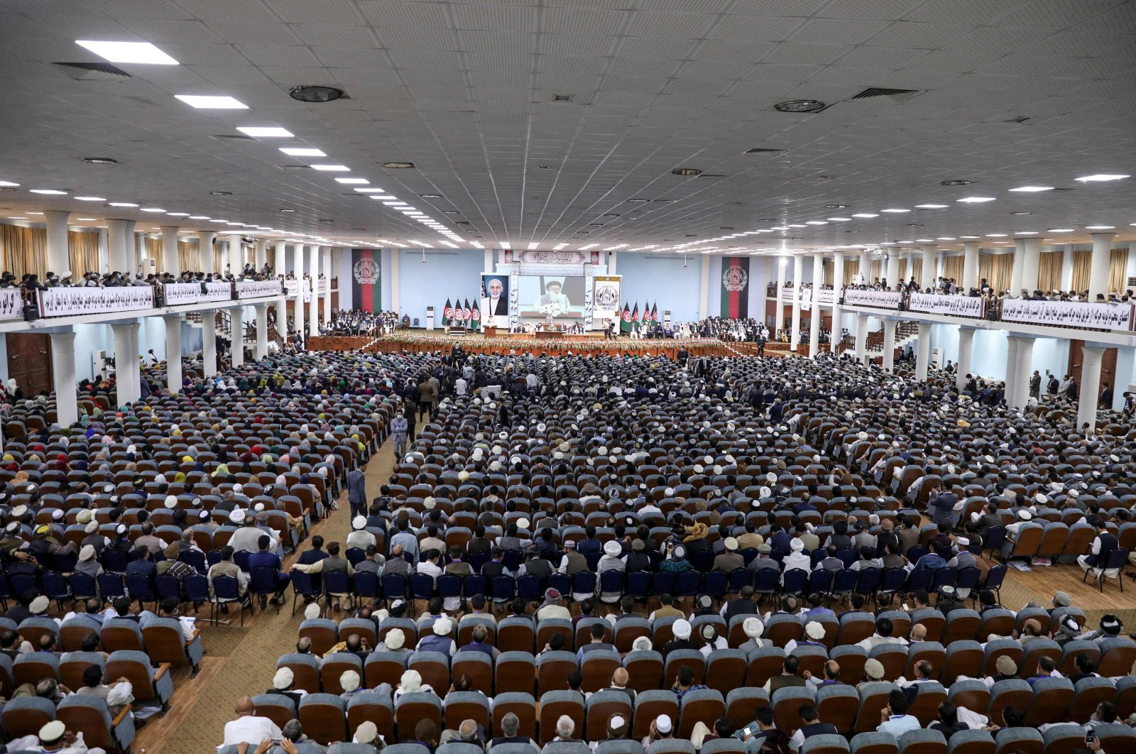 In this handout photograph taken on August 7, 2020 and released by the Press Office of President of Afghanistan, people attend the first day of the Loya Jirga, a grand assembly, at the Loya Jirga Hall in Kabul. (AFP Photo/ Press office of President of Afghanistan)