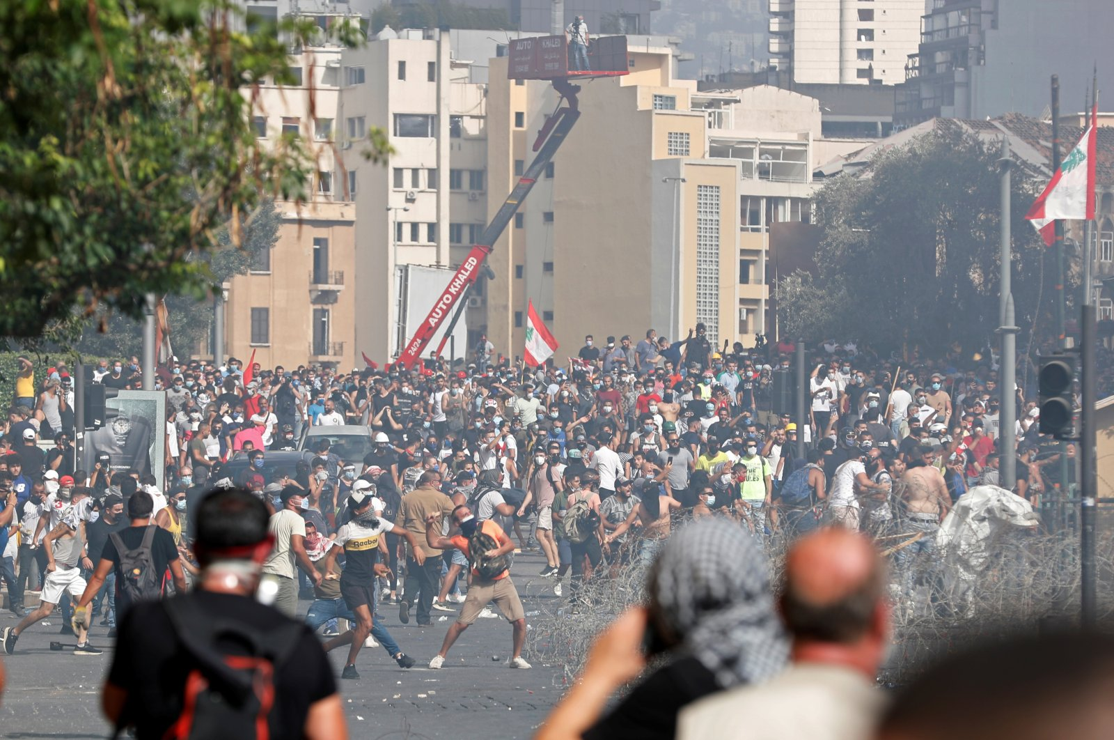 Demonstrators throw stones during a protest as they try to break through a barrier to get to the parliament building following Tuesday's blast, in Beirut, Lebanon August 8, 2020. (REUTERS Photo)