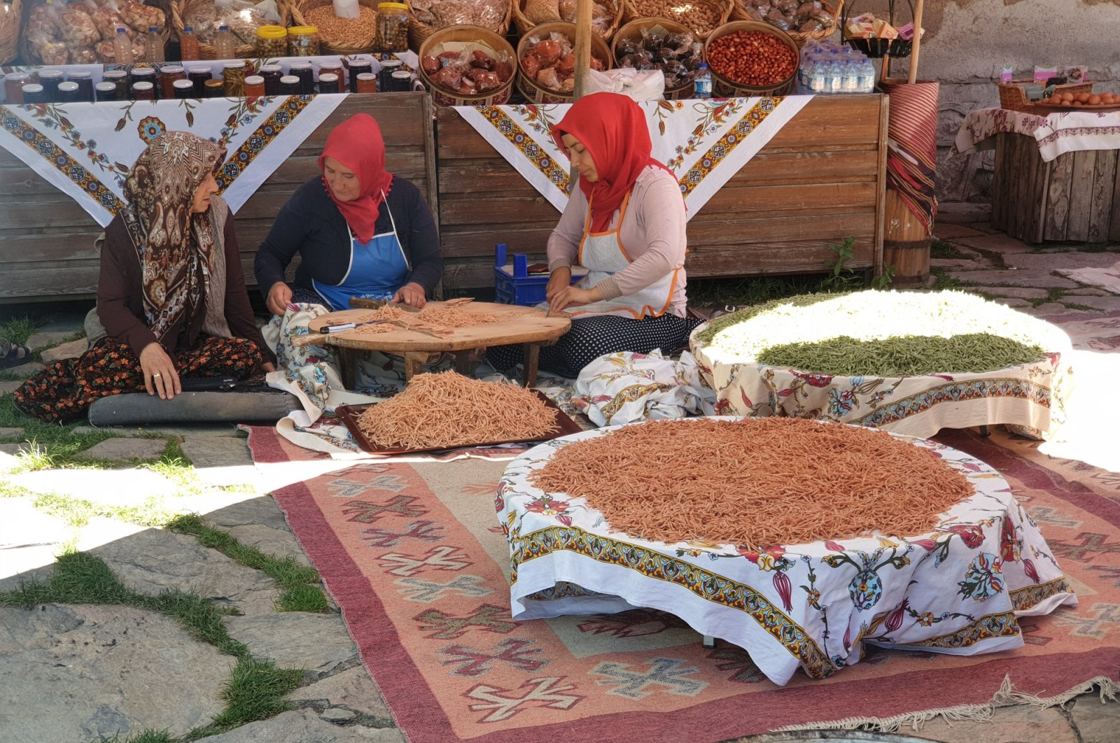 Turkish women living in small villages usually turn the whole process of drying veggies and drying tarhana into a collective event. (iStock Photo)