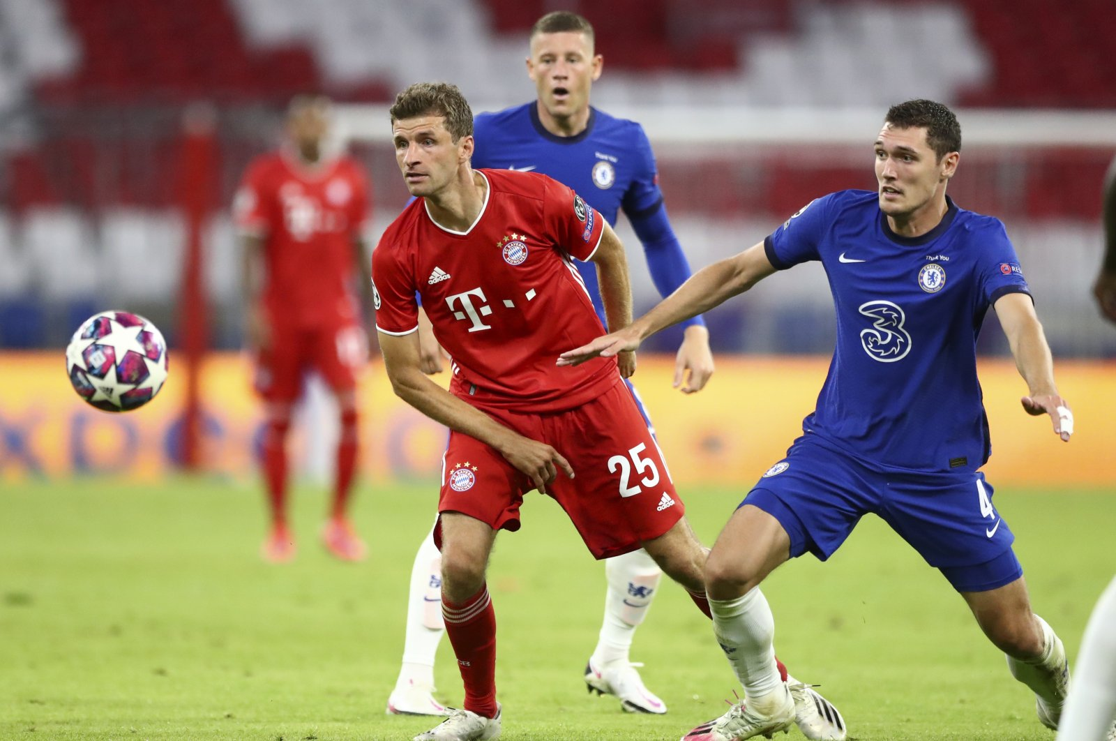 Bayern's Thomas Mueller (L) and Chelsea's Andreas Chistensen chase the ball during the Champions League match in Munich, Germany, Aug. 8, 2020. (AP Photo)