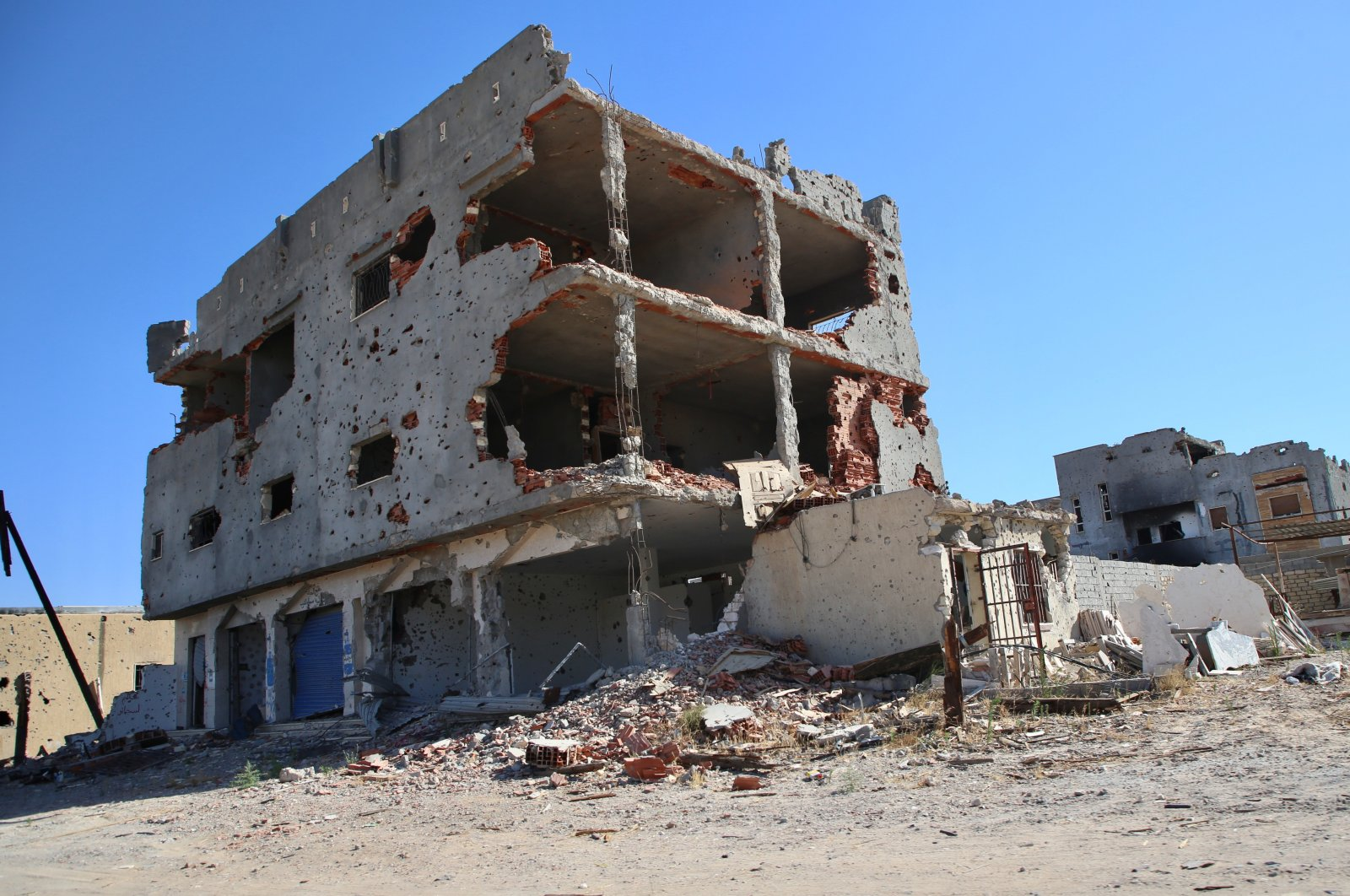 A damaged building is seen south of the capital Tripoli which was liberated by GNA forces from putschist Gen.Khalifa Haftar's militias that launched an offensive on the capital, June 29, 2020 (AA Photo)
