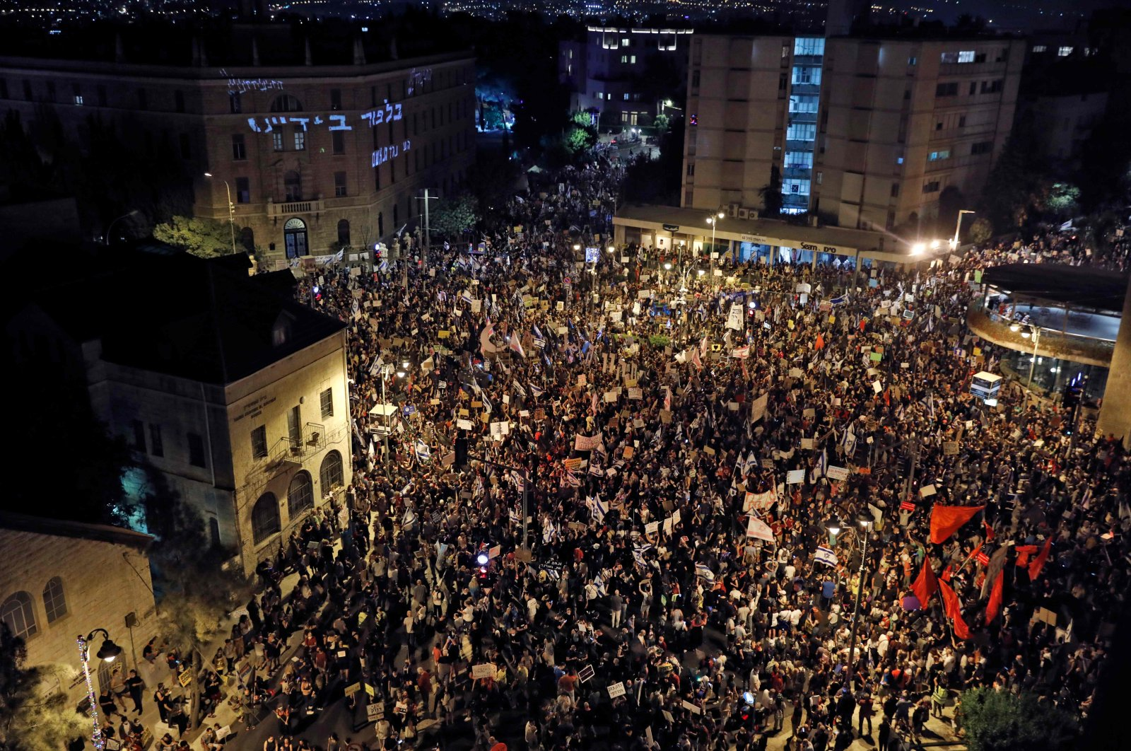 Protesters gather for a demonstration against the Israeli government near the Prime Minister's residence in Jerusalem, Aug. 8, 2020. (AFP Photo)