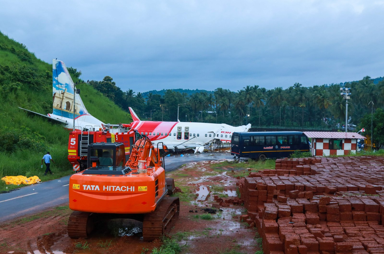 Rescue vehicles near the wreckage of an Air India Express jet at Calicut International Airport in Karipur, Kerala, Aug. 8, 2020. (AFP Photo)