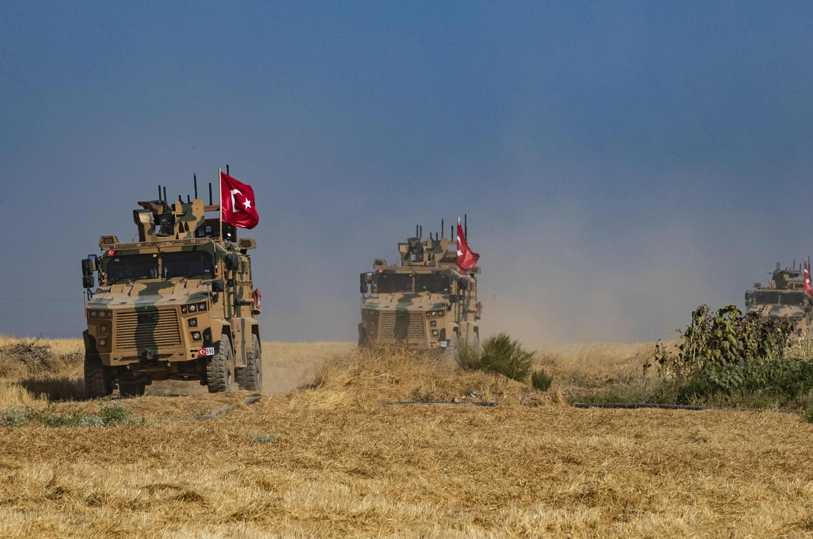 Turkish military vehicles patrol in the Syrian village of al-Hashisha on the outskirts of Tal Abyad town along the border with Turkey following a cross-border anti-terror operation against YPG terrorists, Oct. 4, 2019. (AFP Photo)