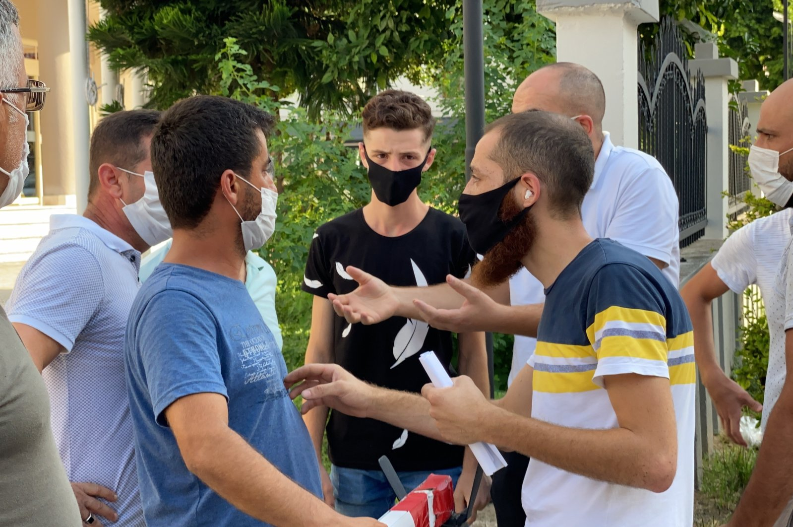 Members of Şahin and Burka families argue near the hospital in Hatay, Turkey, Aug. 9, 2020. (IHA Photo)