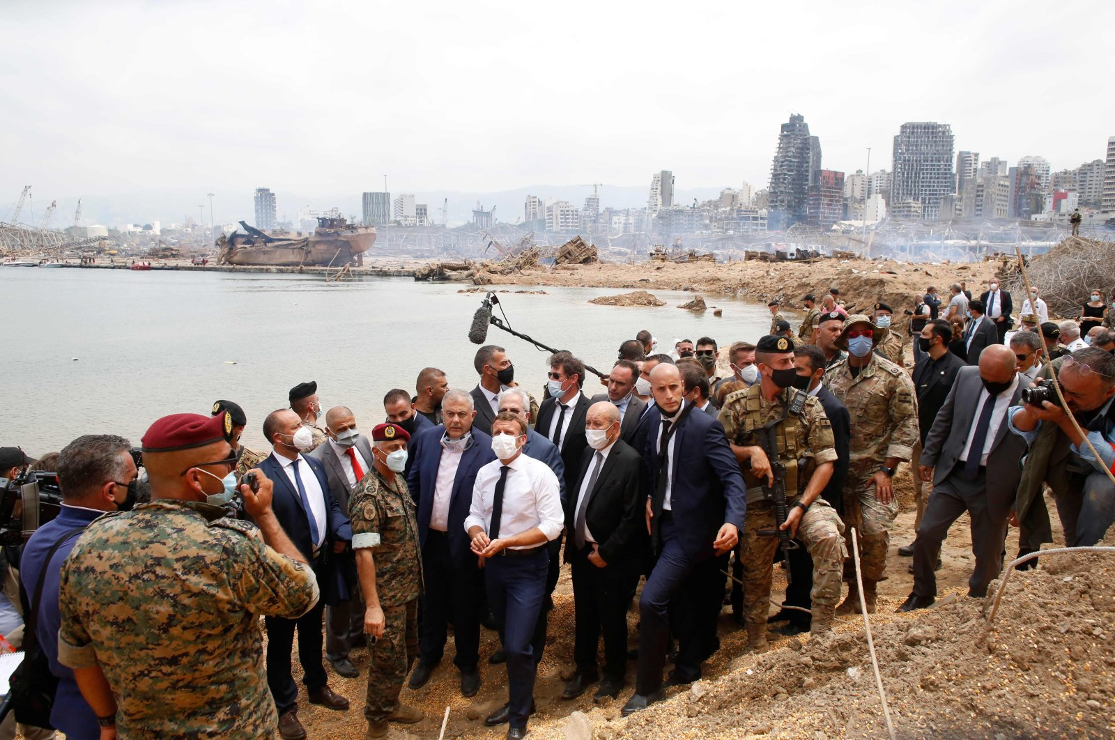 French President Emmanuel Macron (C) visits the devastated site of the explosion at the port of Beirut, Aug. 6, 2020. (AFP Photo)