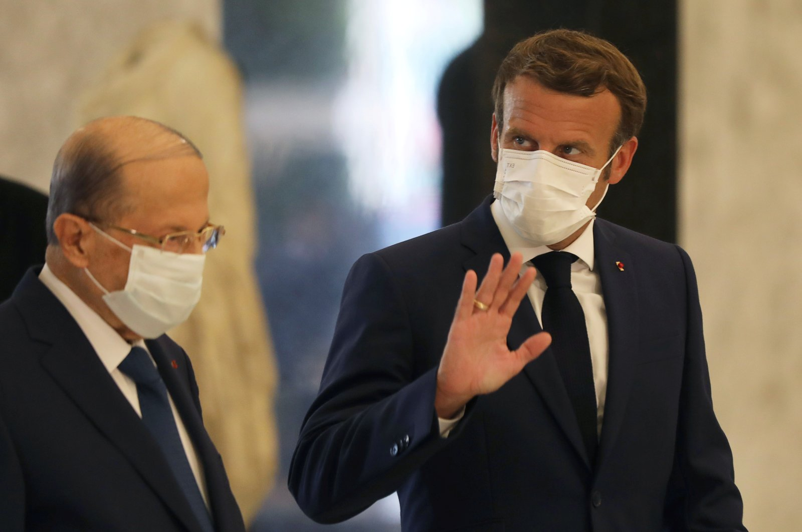 French President Emmanuel Macron and Lebanese President Michel Aoun wear protective face masks as they meet following the explosion in Beirut's port area, at the presidential palace in Baabda, Lebanon, Aug. 6, 2020. (Reuters Photo)