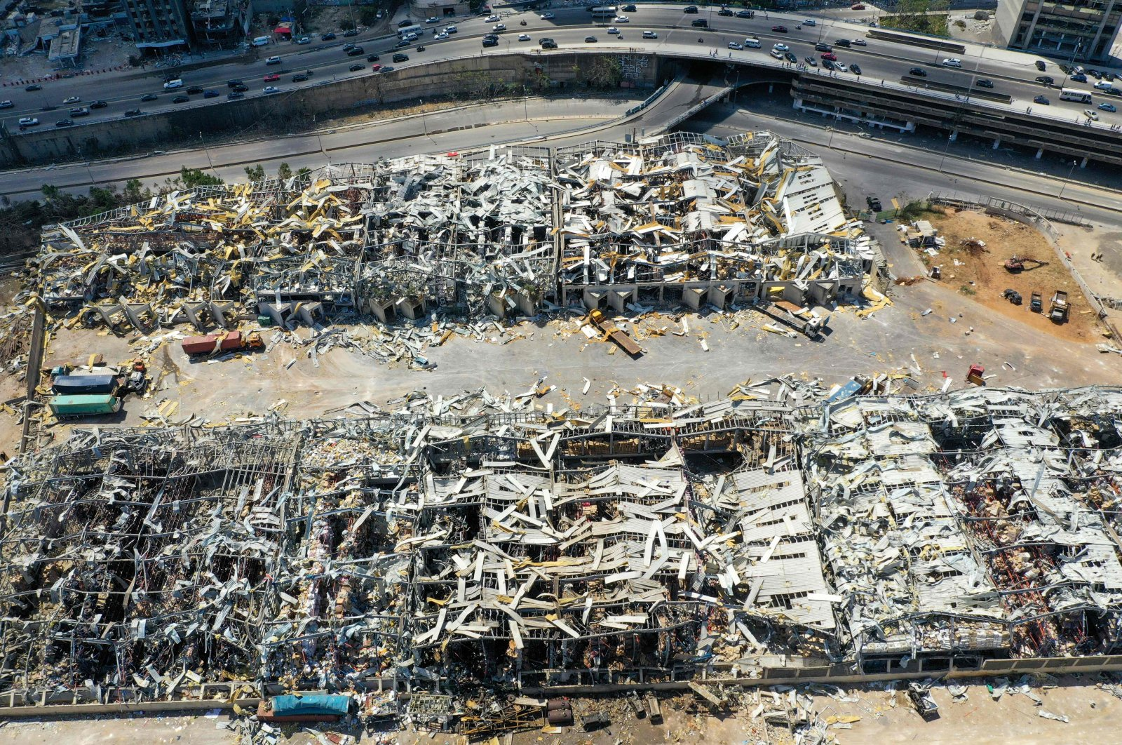 An aerial view taken on Aug. 9, 2020, shows a partial view of the port of Beirut, damaged as a result of the colossal explosion of a huge pile of ammonium nitrate that had languished for years in a port warehouse, leaving scores of people dead or injured and causing devastation in the Lebanese capital. (AFP Photo)