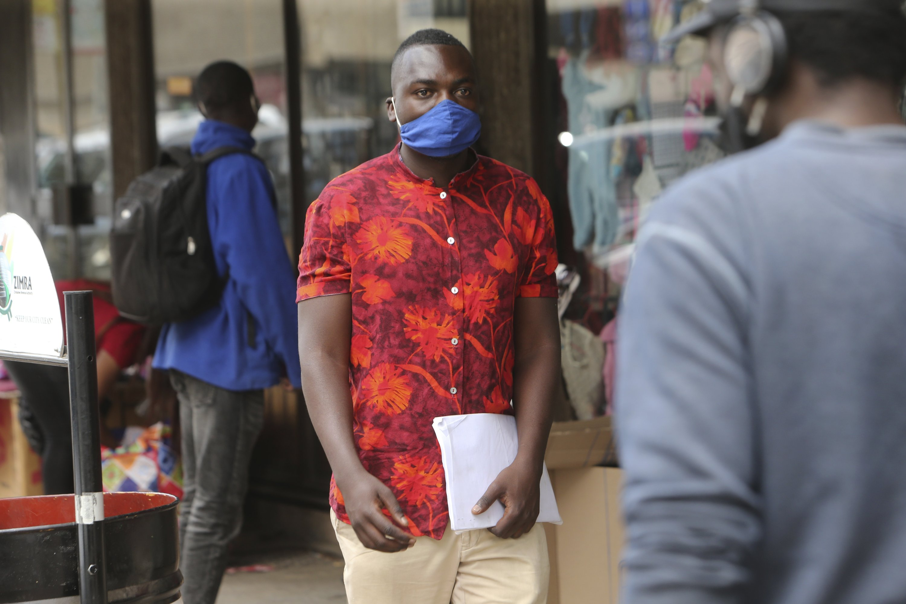 Emmanuel Reyai walks on the streets of Harare, Zimbabwe, while looking for a job, Aug. 5, 2020. (AP Photo)