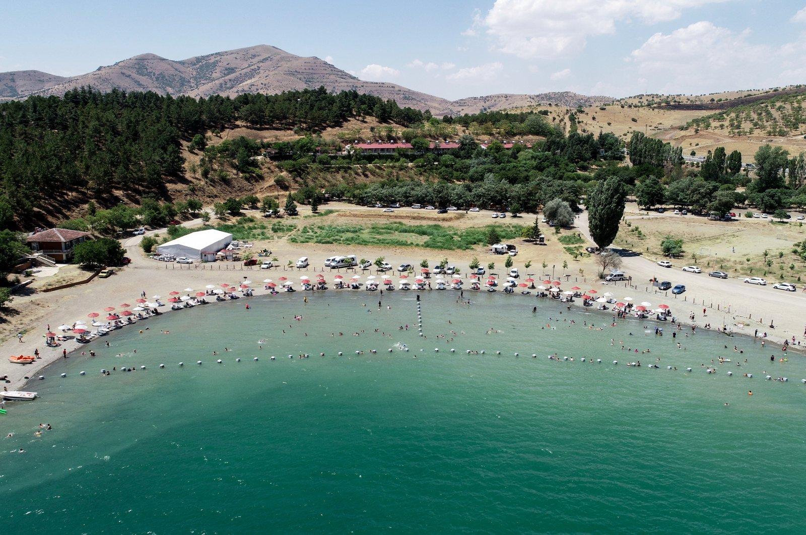Vacationers on sunbeds are seen at Lake Hazar in Elazığ province, eastern Turkey, Aug. 7, 2020. (AA Photo)