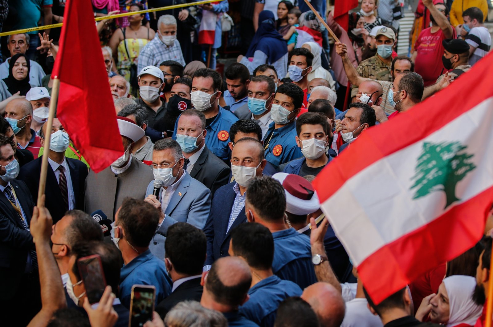Turkey's Vice President Fuat Oktay and Foreign Minister Mevlüt Çavuşoğlu are seen encircled by an enthusiastic crowd in Beirut, Lebanon, Aug. 8, 2020 (AA Photo)