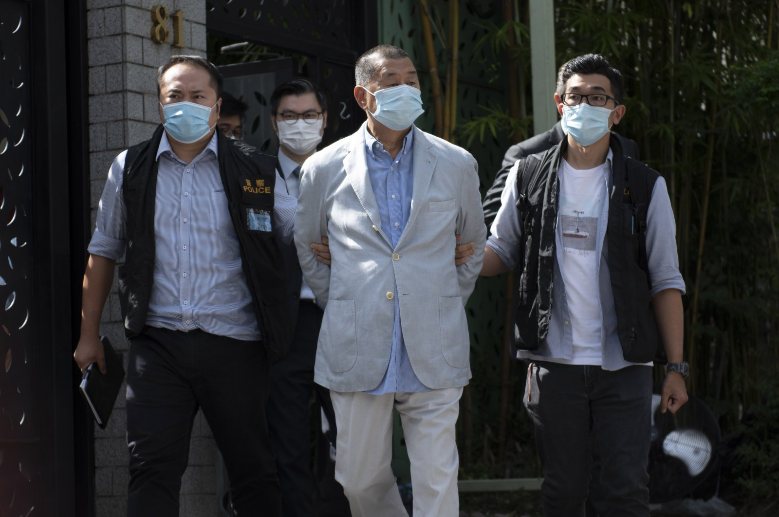 Jimmy Lai (C), media tycoon and founder of Apple Daily, is escorted by police after he was arrested at his home in Hong Kong, China, Aug. 10, 2020. (EPA Photo)