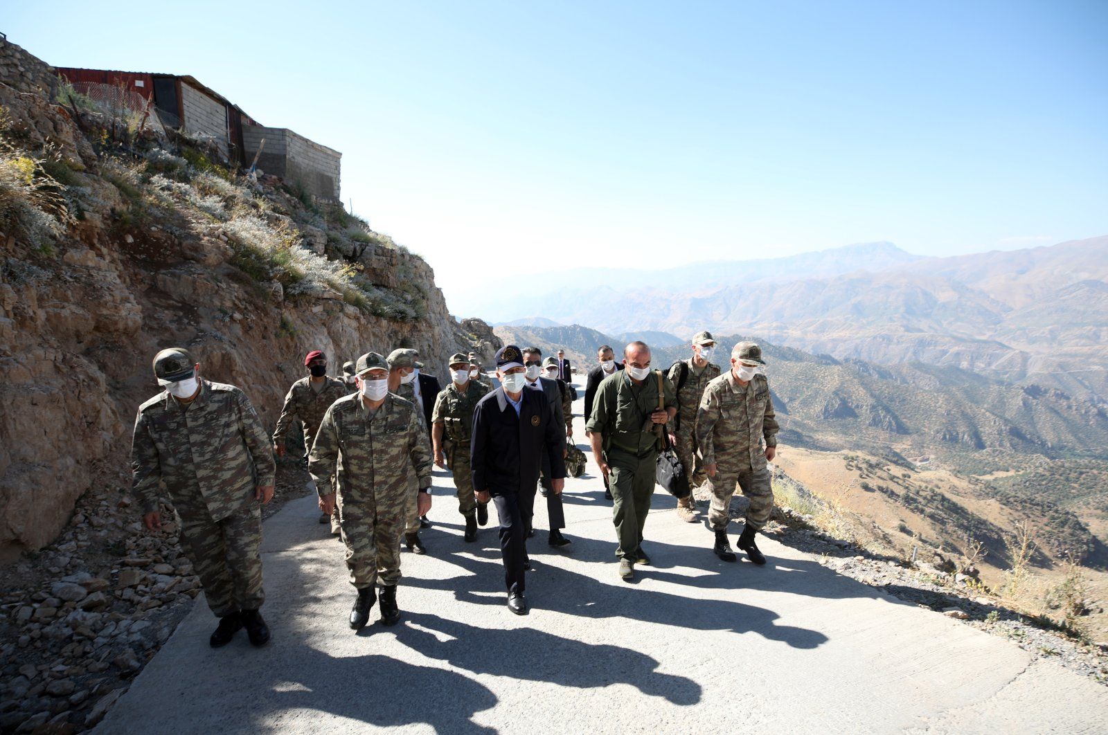Defense Minister Hulusi Akar inspects the border troops in Turkey's southeastern Şırnak province with Chief of General Staff Gen. Yaşar Güler and Land Forces Commander Gen. Ümit Dündar, Aug. 9, 2020. (AA Photo)