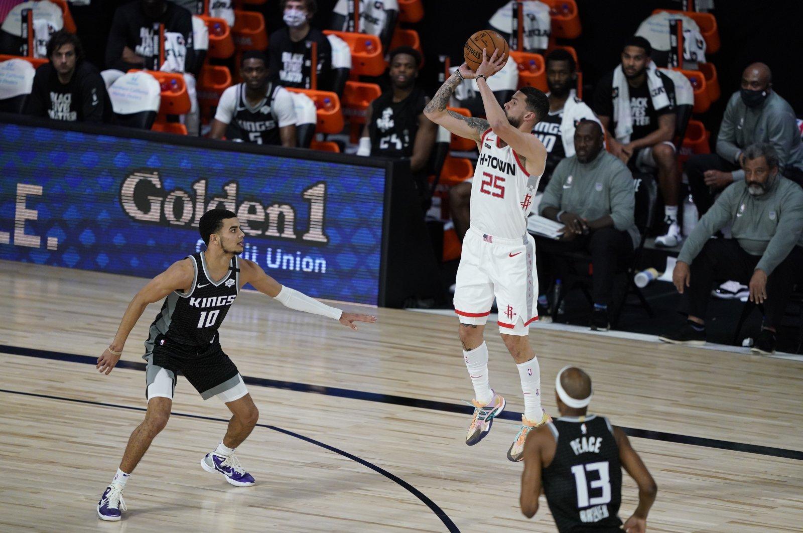 Houston Rockets' Austin Rivers shoots over Sacramento Kings' Justin James (10) during an NBA game in Lake Buena Vista, Florida, U.S., Aug. 9, 2020. (AP Photo)