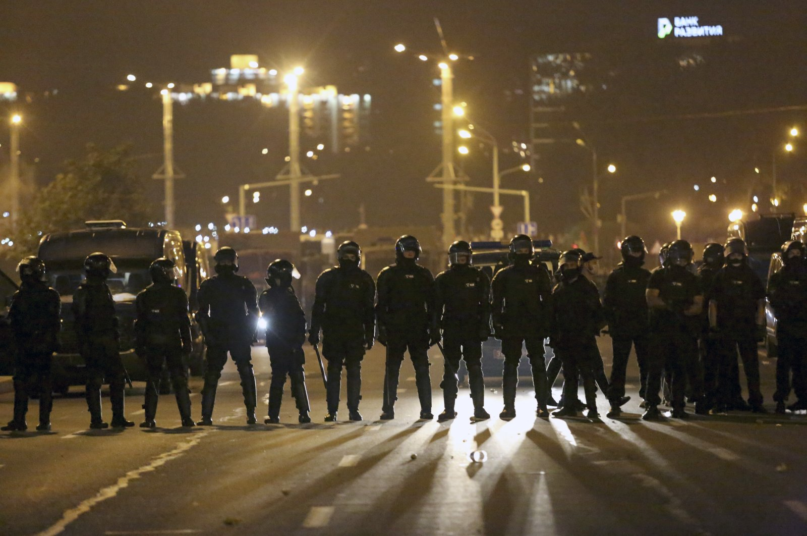 Police block the road to protect against demonstrators after the Belarusian presidential election, Minsk, Belarus, Aug. 9, 2020. (AP Photo)