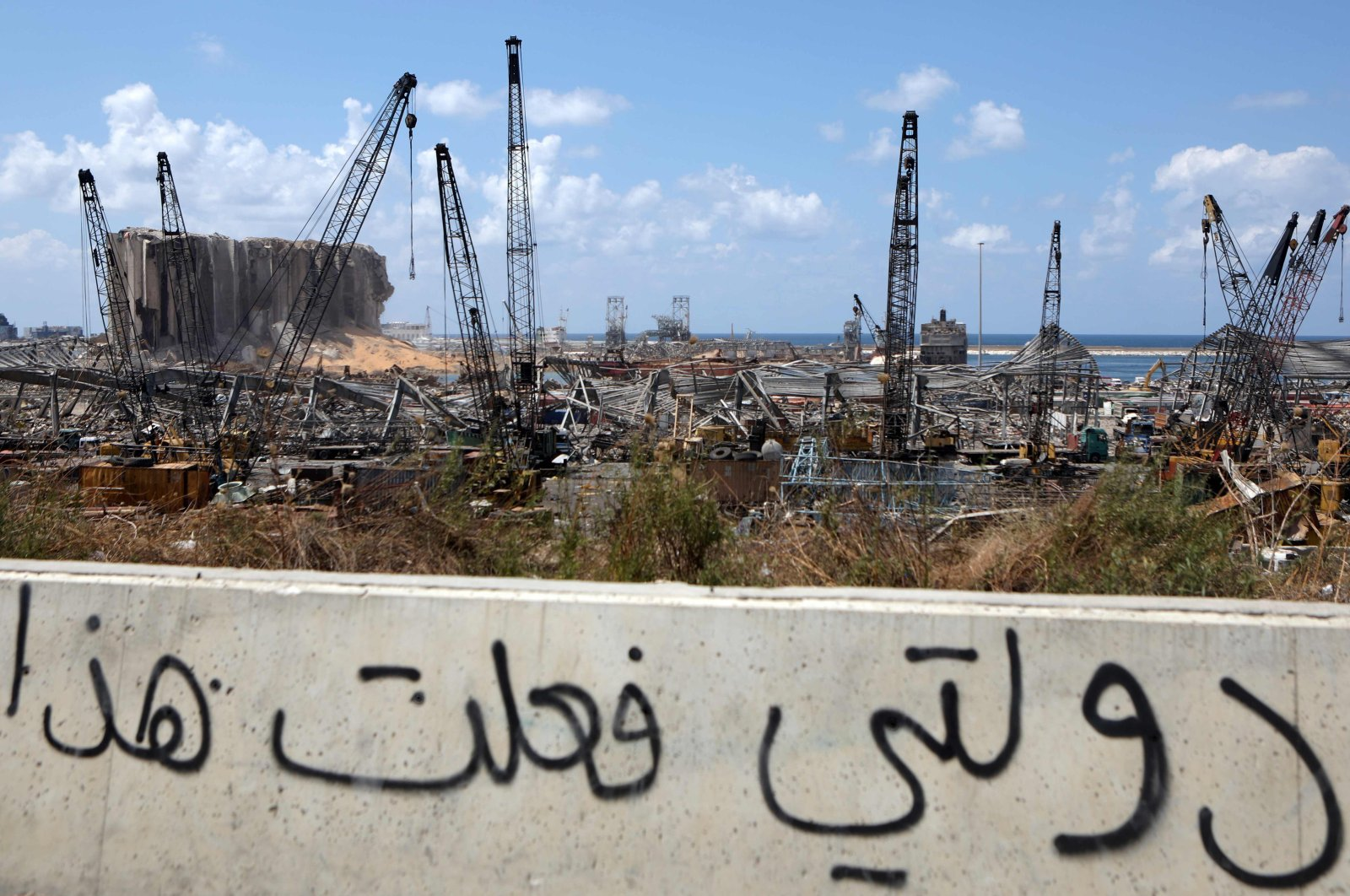"""A view of graffiti drawn on the side of a road reads in Arabic, """"My country did this,"""" Beirut, Lebanon, Aug. 9, 2020. (AFP Photo)"""
