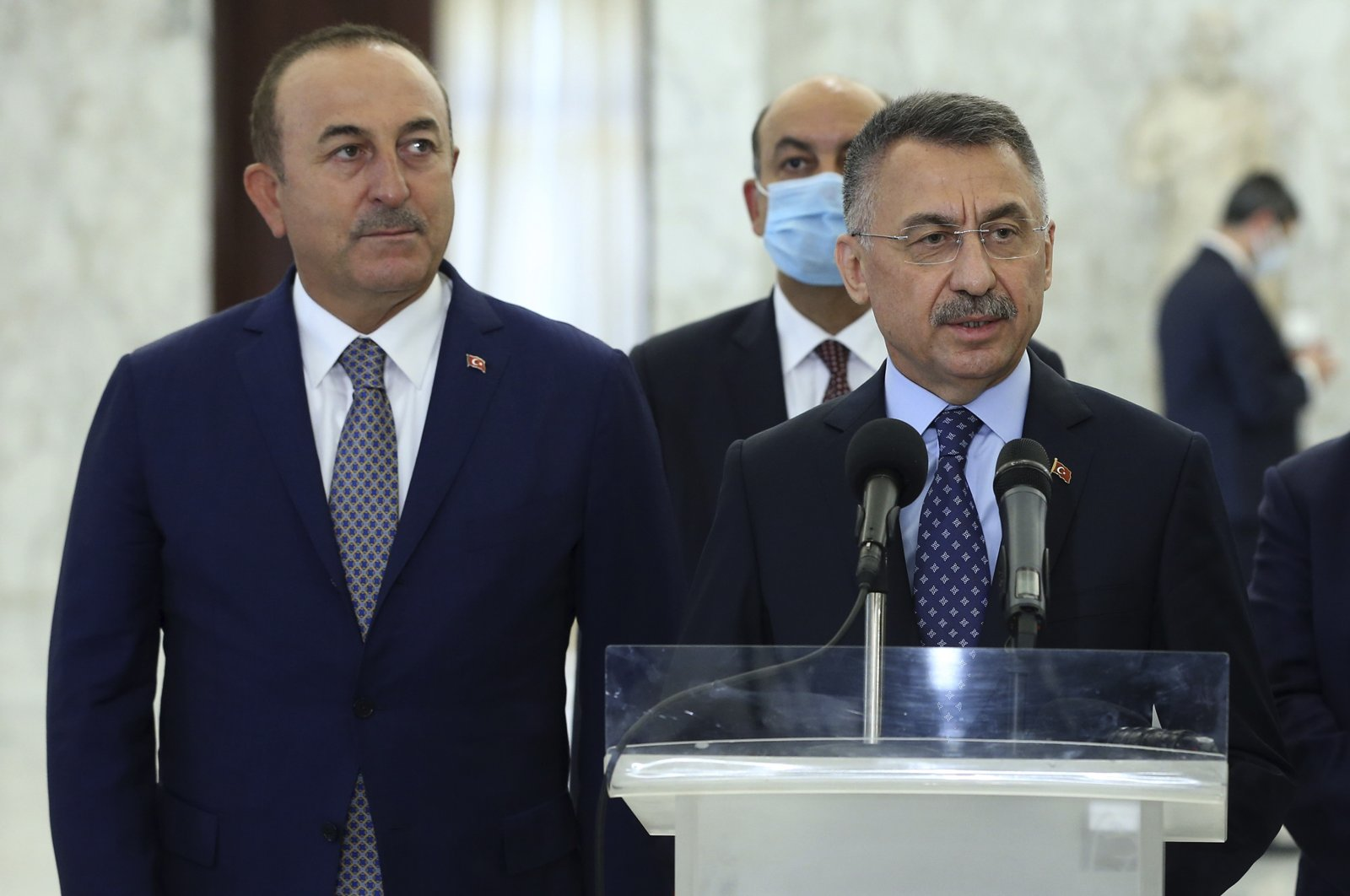 Turkish Foreign Minister Mevlüt Çavuşoğlu (L) and Vice President Fuat Oktay speak to reporters after their meeting with Lebanese President Michel Aoun at the presidential palace, Beirut, Lebanon, Aug. 8, 2020. (AP Photo)