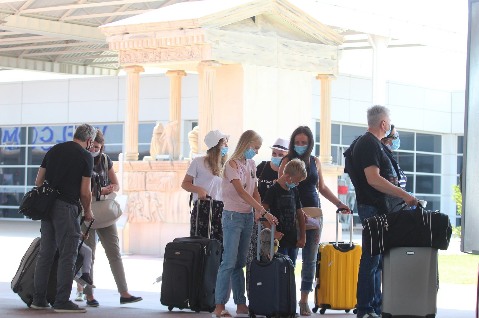 Russian tourists arrive at Antalya Airport, Antalya province, southern Turkey, July 10, 2020. (IHA Photo)