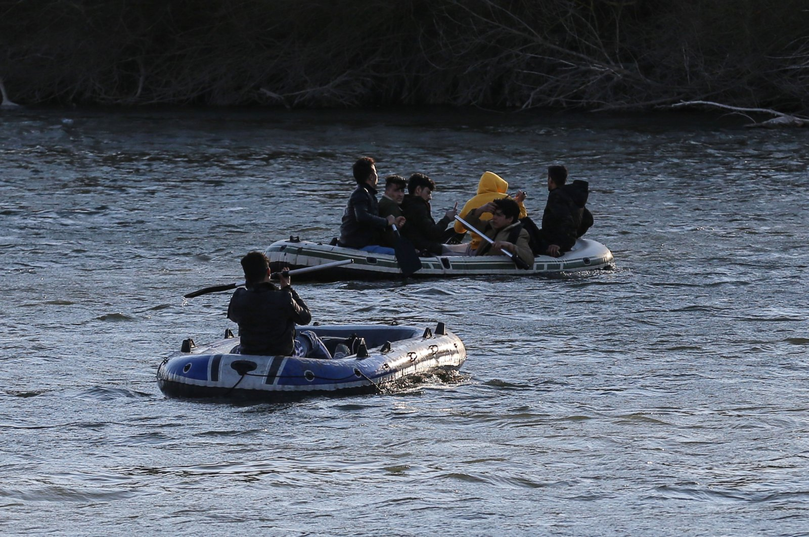 Migrants and refugees are seen on rubber boats on the Maritsa River located between Turkey and Greece, March 4, 2020. (AA Photo)