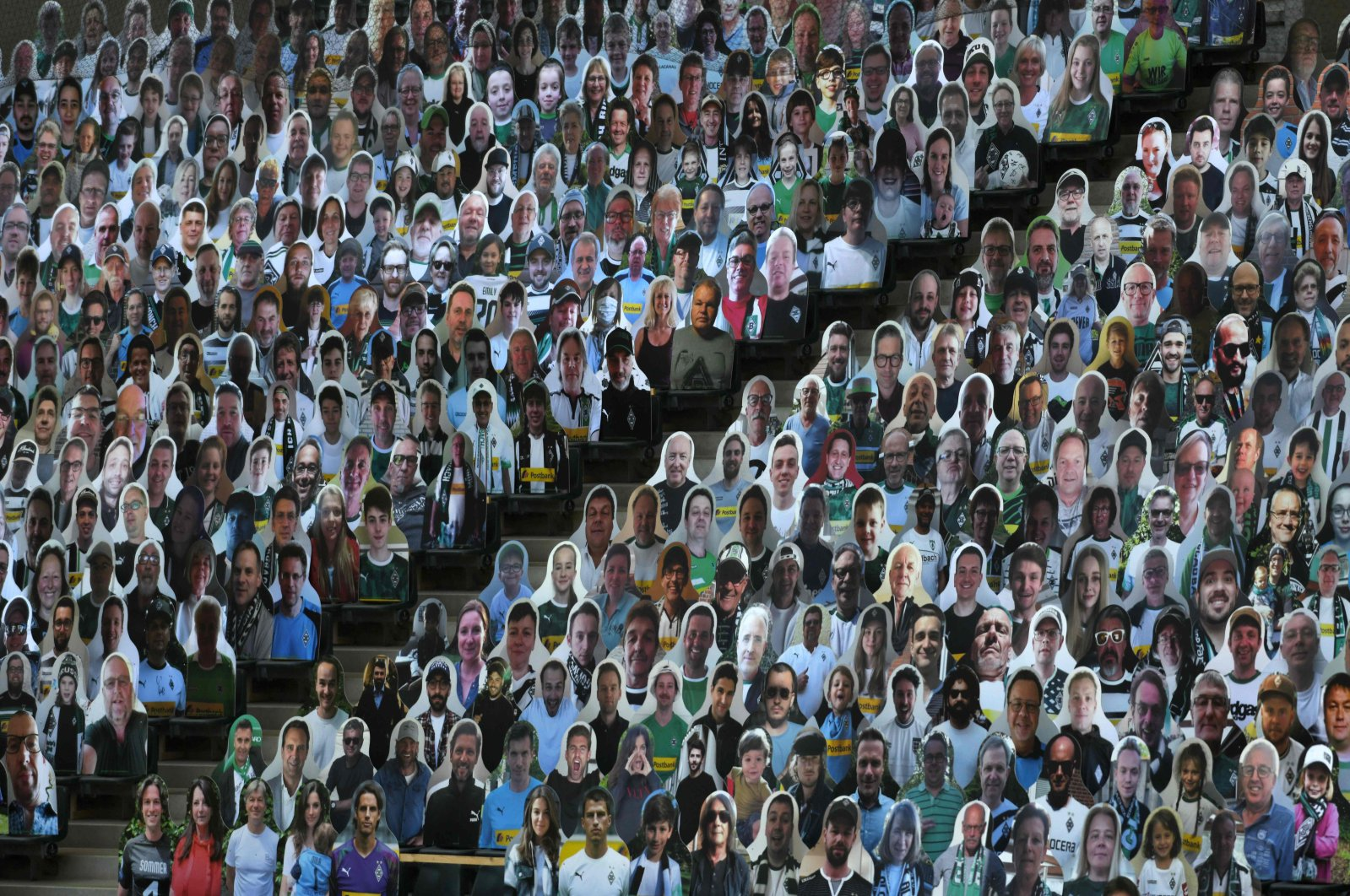 In this May 19, 2020, file photo, cardboard cut-outs with portraits of Borussia Monchegladbach's supporters are seen at the Borussia Park football stadium in Monchengladbach, western Germany. (AFP Photo)