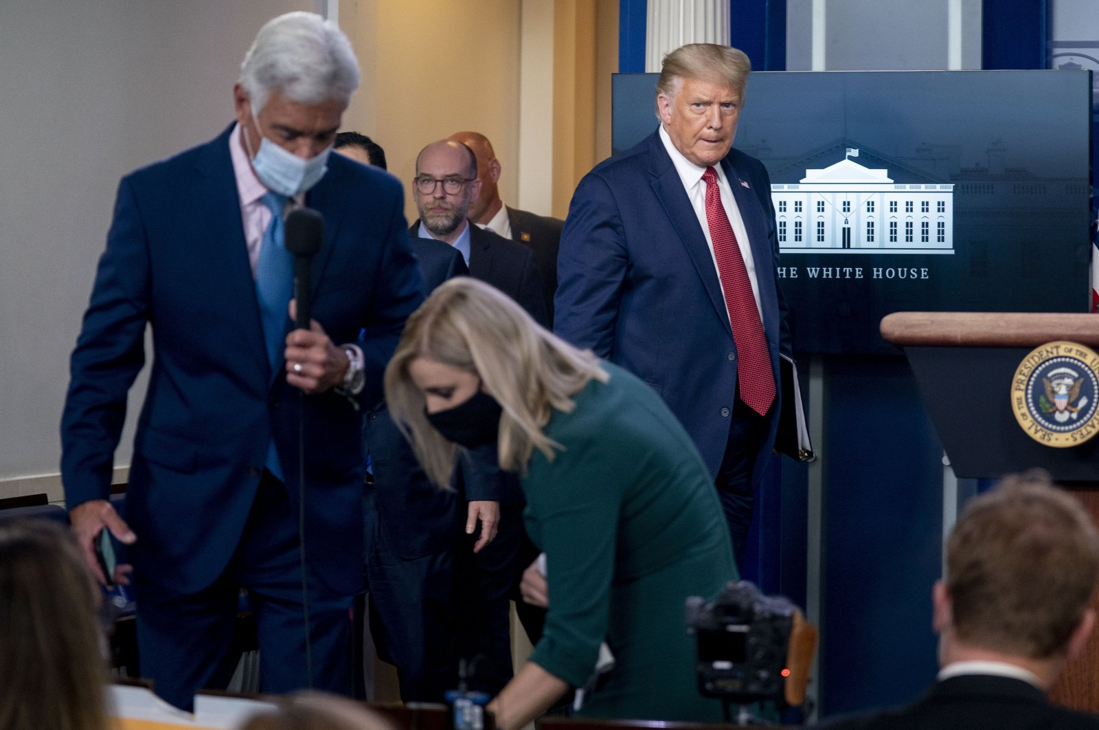 President Donald Trump returns to a news conference in the James Brady Press Briefing Room after he briefly left because of a security incident outside the fence of the White House, Washington D.C., Aug. 10, 2020. (AP Photo)