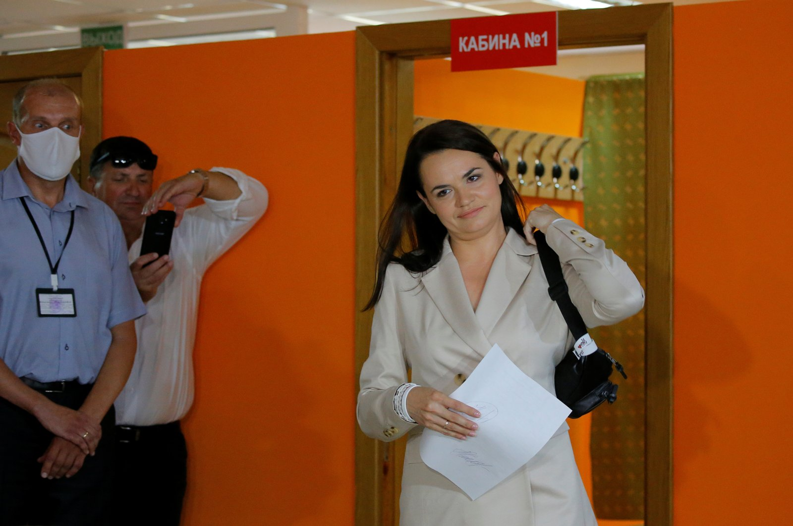 Belarusian united opposition candidate Svetlana Tikhanouskaya walks out of a voting booth before casting her ballot at a polling station during the presidential election in Minsk, Belarus, Aug. 9, 2020. (Reuters Photo)
