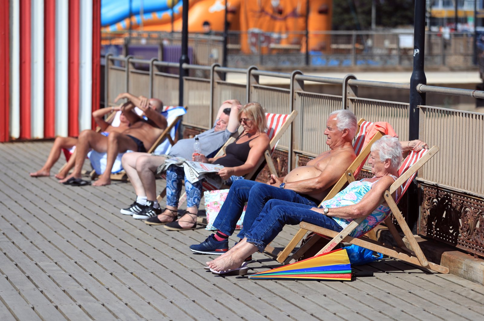 People sunbathe in Skegness, a seaside town in Lincolnshire in England on Aug. 7, 2020. (PA via Reuters)