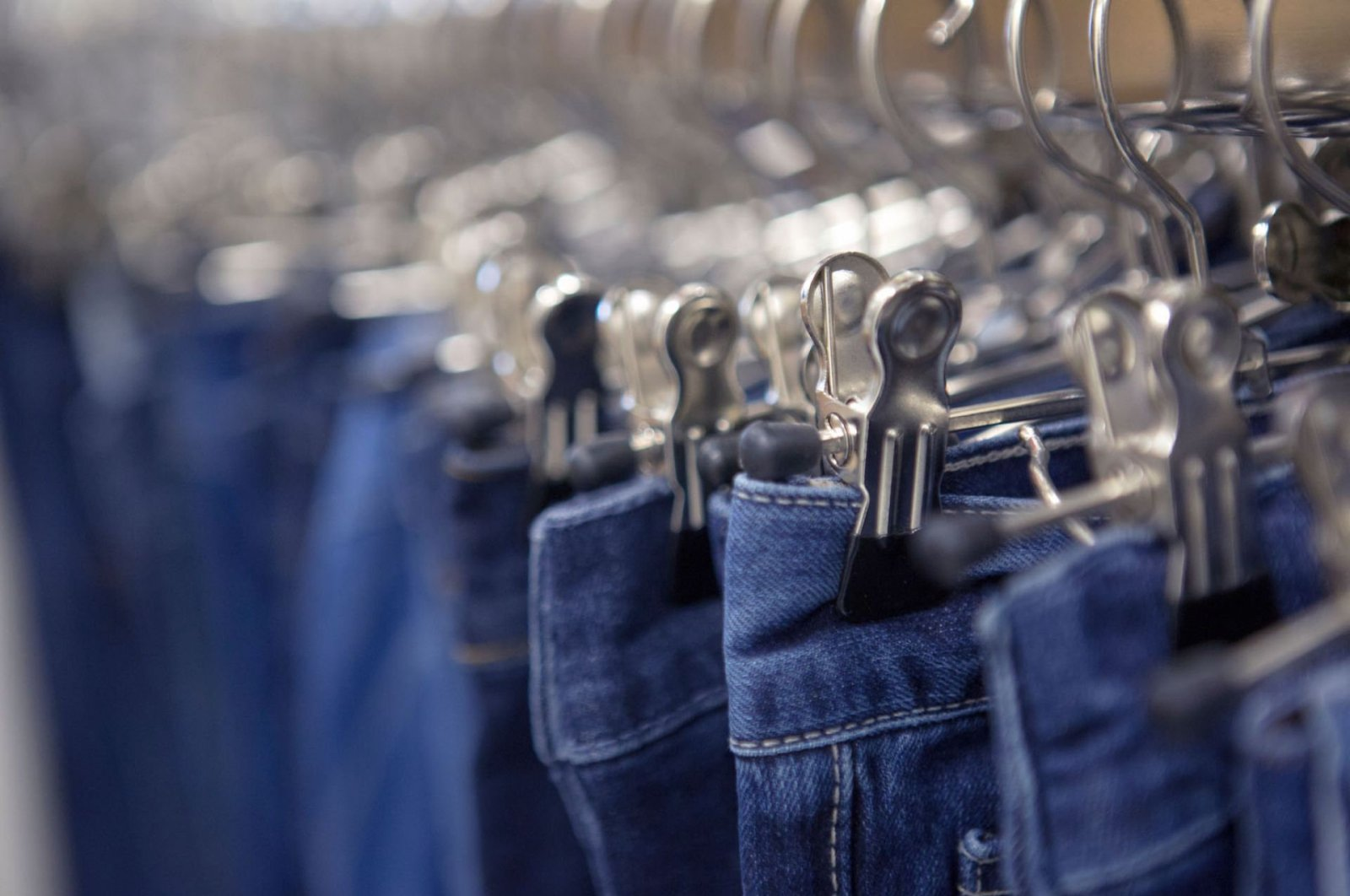 An undated photo shows a rack of blue jeans. (Sabah File Photo)