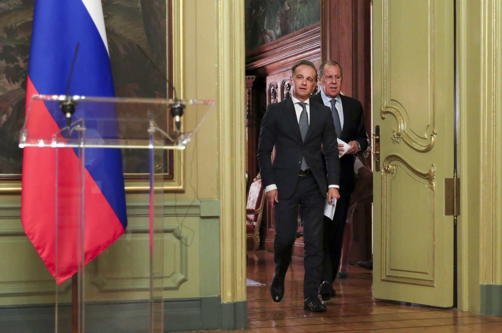 Russian Foreign Minister Sergey Lavrov (R), and German Foreign Minister Heiko Maas, enter a hall to attend their joint news conference following talks in Moscow, Russia, Aug. 11, 2020. (Russian Foreign Ministry Press Service via AP)