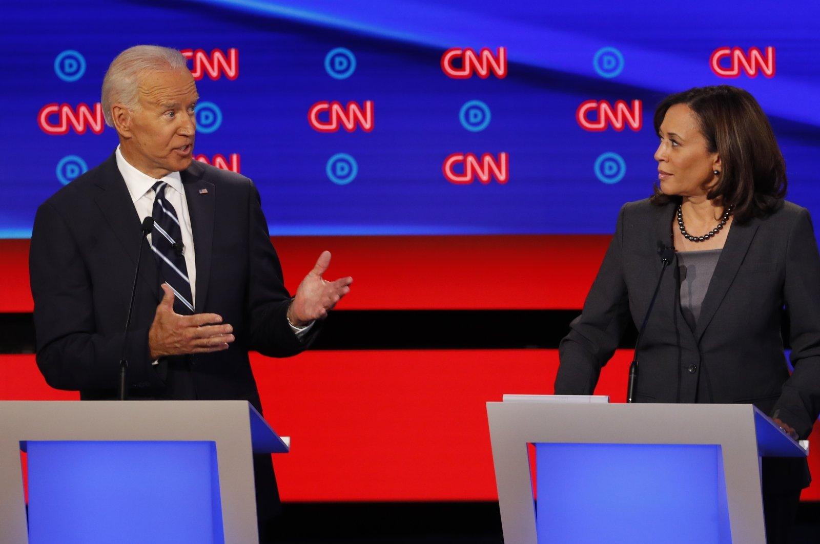 Joe Biden and Sen. Kamala Harris participate in Democratic presidential primary debates in Detroit, U.S., July 31, 2019. (AP Photo)