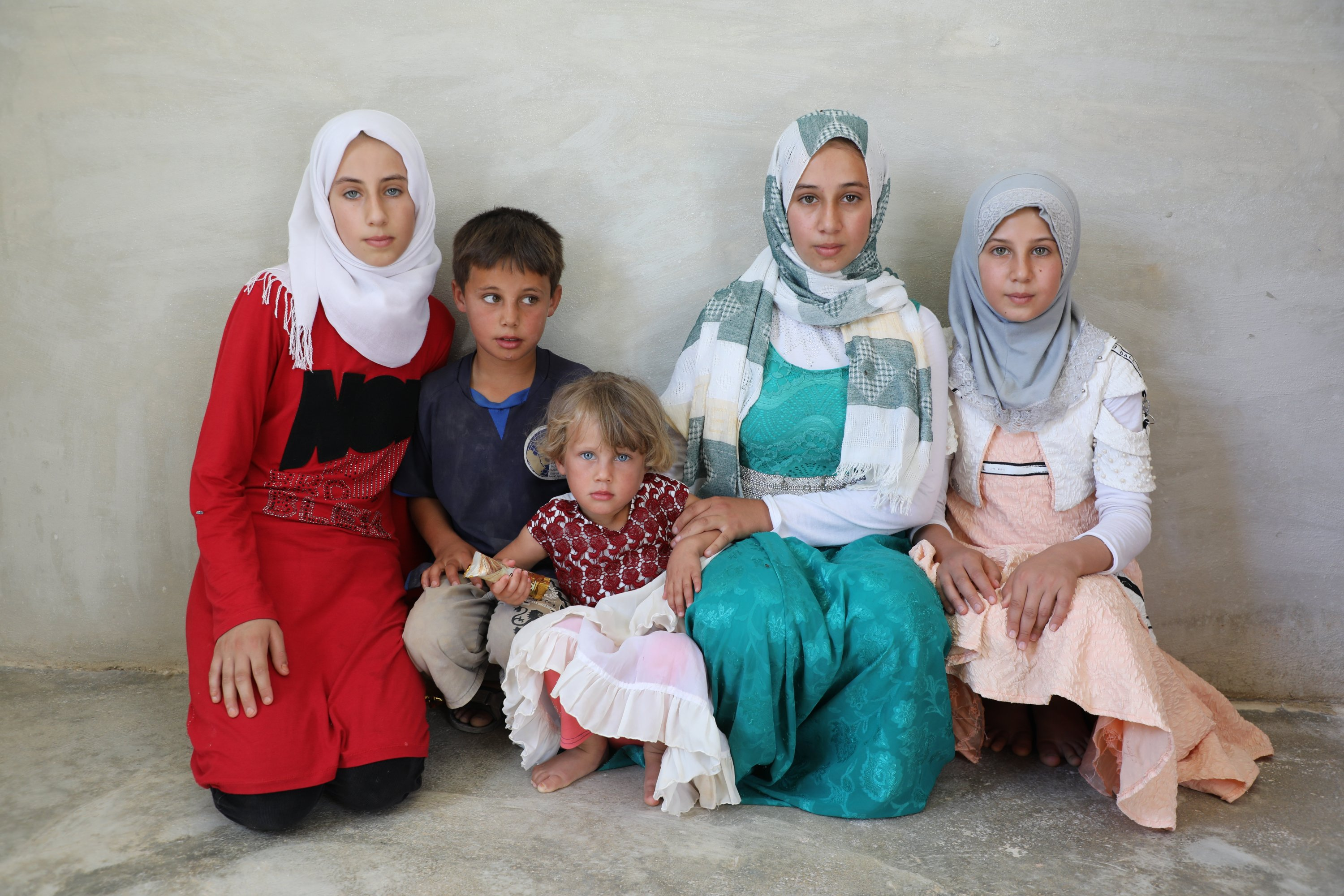 Sisters – Meryem, Mara, Rama and Mariyya – migrated to Idlib along with their grandmother and mother and settled in the new briquette houses a month ago.