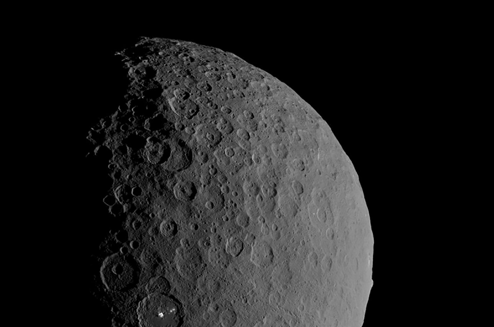 Occator Crater and Ahuna Mons appear together in this view of the dwarf planet Ceres obtained by NASA's Dawn spacecraft on Feb. 11, 2017. (NASA/JPL-Caltech/UCLA/MPS/DLR/IDA handout via Reuters)
