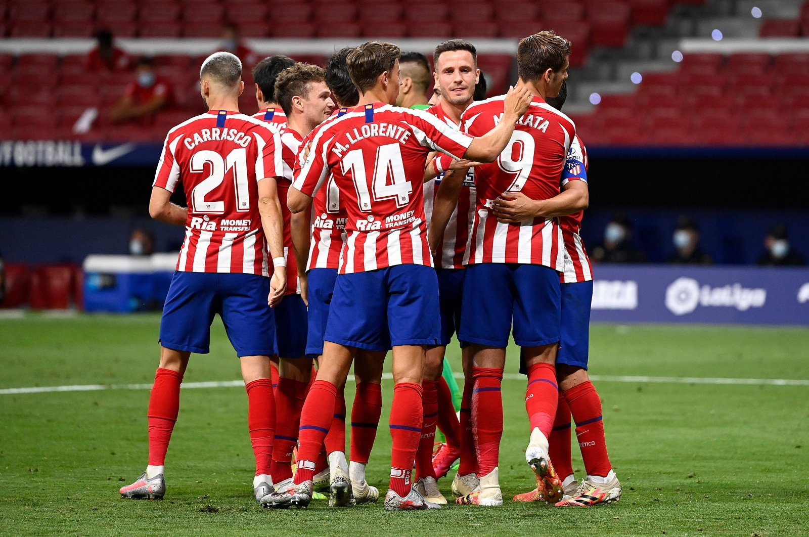 Atletico Madrid's players celebrate during a Spanish La Liga football match against Mallorca, in Madrid, Spain, July 3, 2020. (AFP Photo)