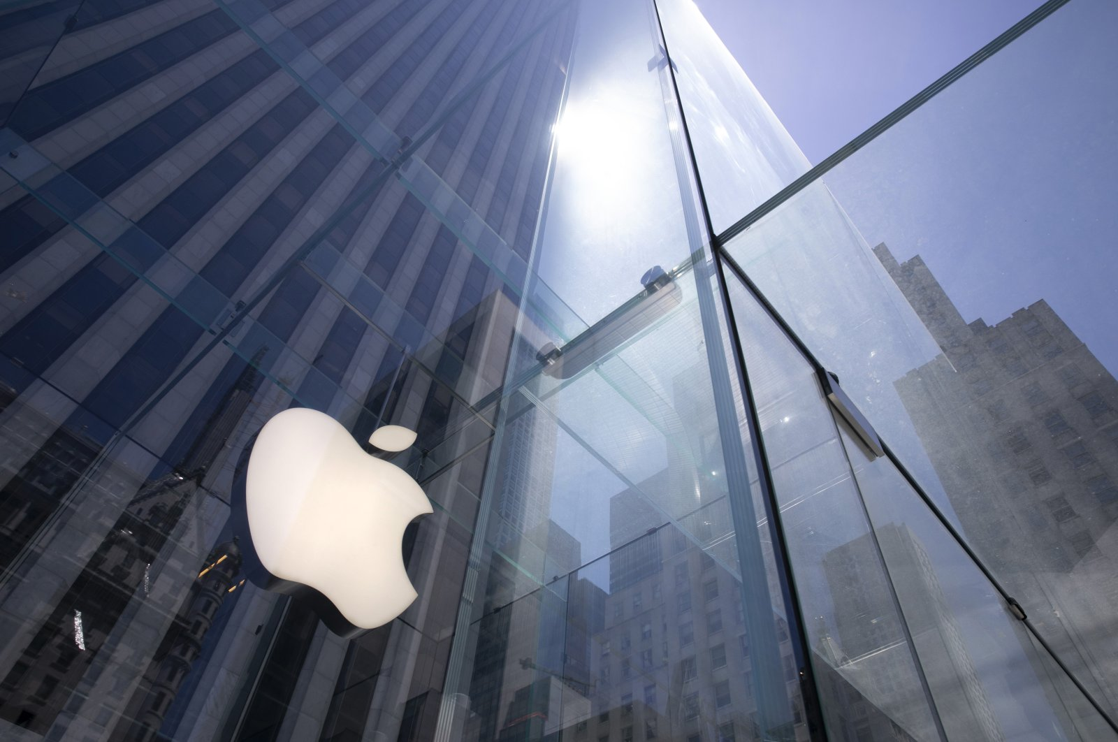 In this June 16, 2020 file photo, the sun is reflected on Apple's Fifth Avenue store in New York. (AP Photo)