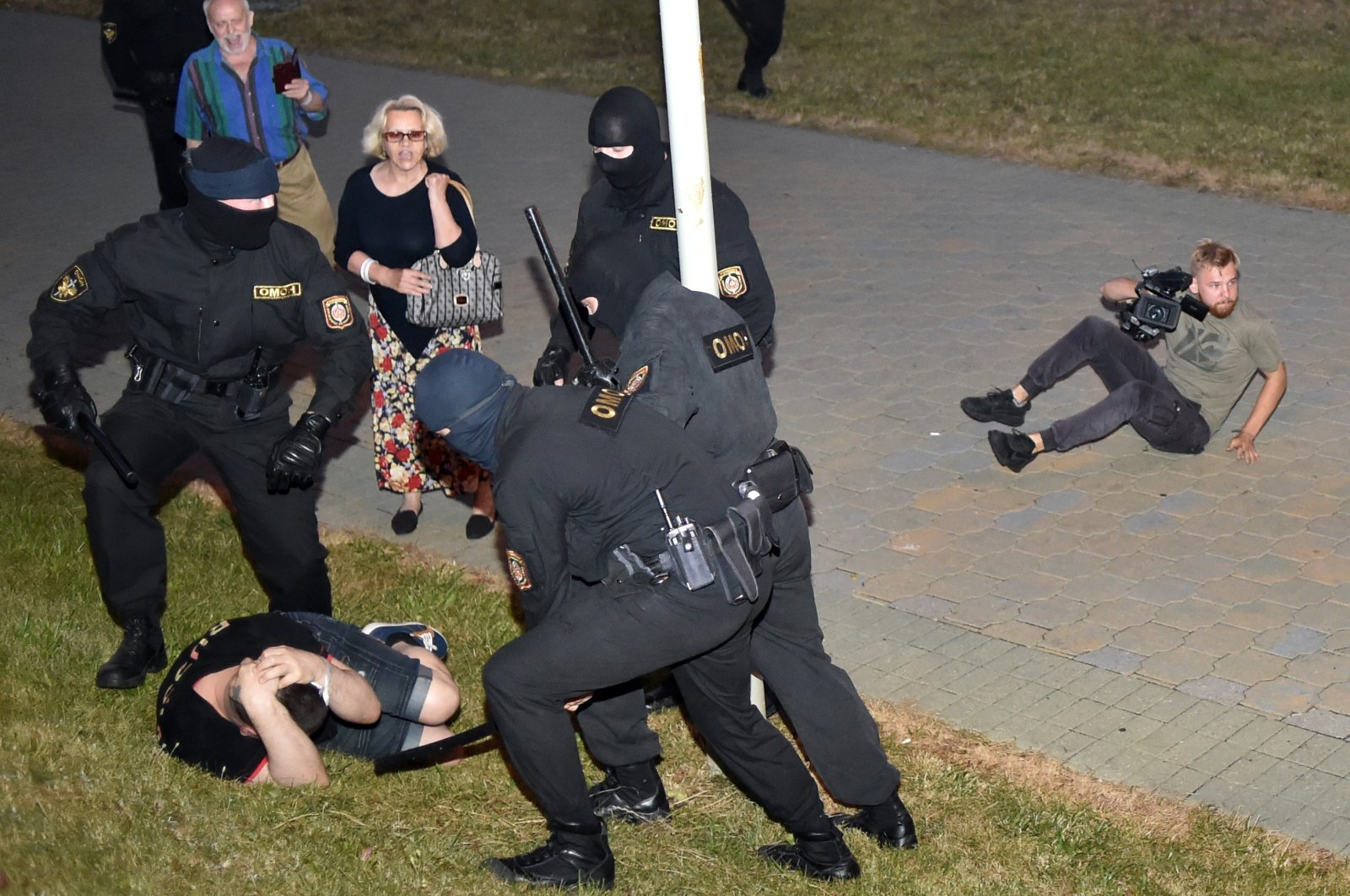 Riot police detain a demonstrator during a protest after polls closed in Belarus' presidential election, in Minsk, Belarus, Aug. 9, 2020. (AFP Photo)