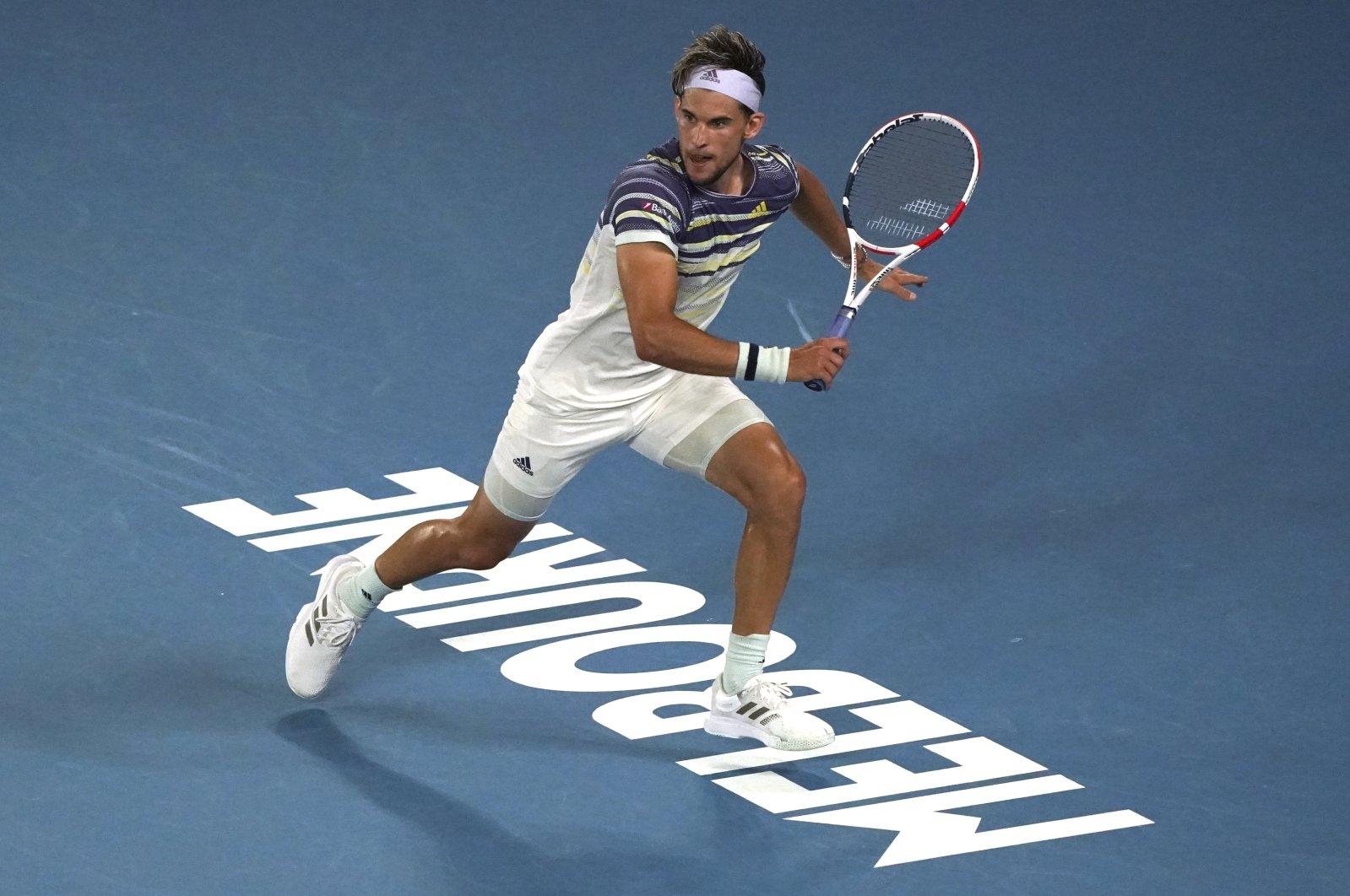 Dominic Thiem runs to play a shot to Rafael Nadal during a quarterfinal match at the Australian Open tennis championship in Melbourne, Australia, Jan. 29, 2020. (AP Photo)