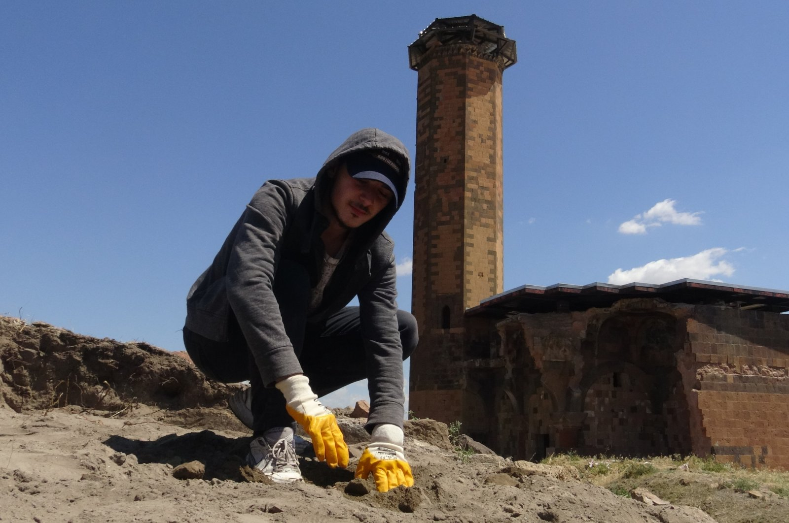 A young man is seen at the excavation site at Ebu'l Manuçehr Mosque, Kars, eastern Turkey.