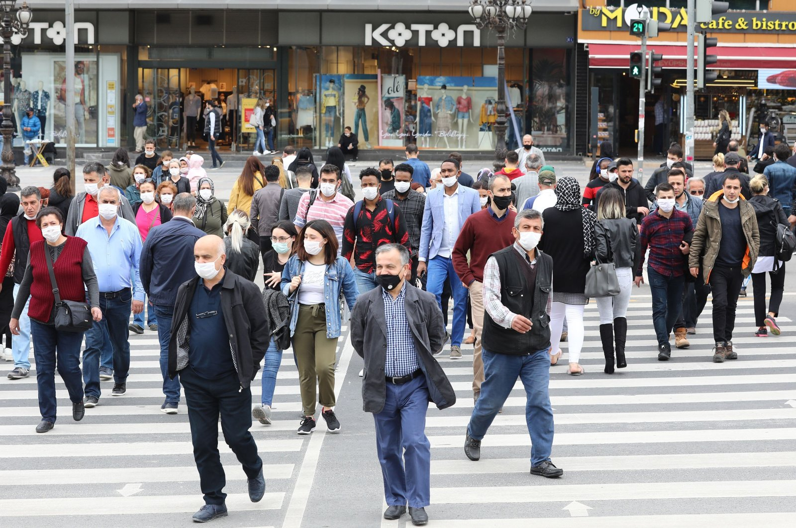 People wearing protective face masks walk on a street in the capital Ankara, Turkey, June 1, 2020. (AFP Photo)