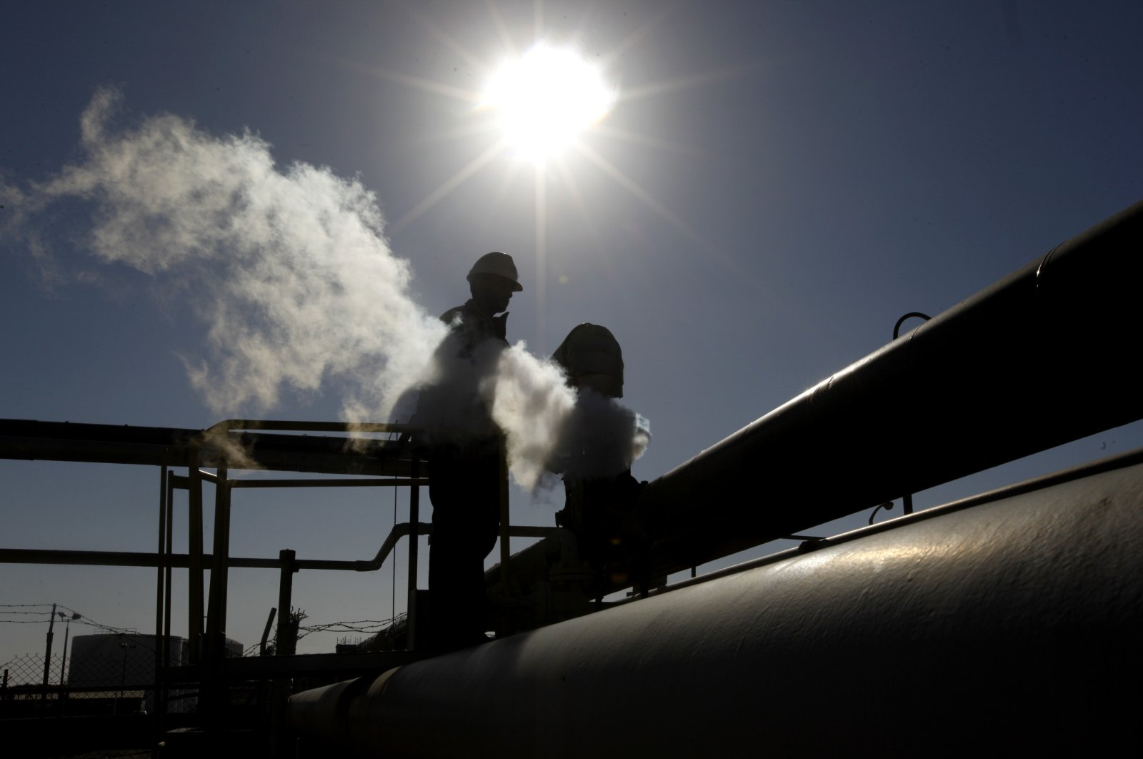 In this file photo, a Libyan oil worker, works at a refinery inside the Brega oil complex, in Brega, eastern Libya, Feb. 26, 2011. (AP File Photo)