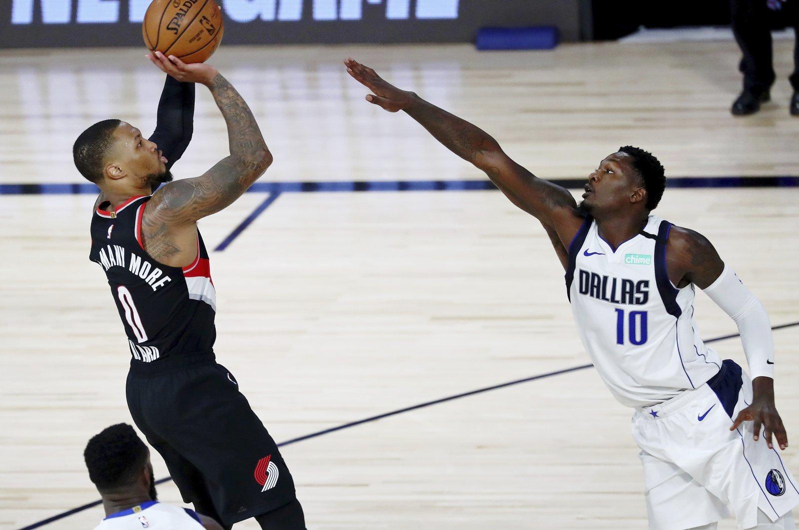 Portland Trail Blazers guard Damian Lillard shoots as Dallas Mavericks forward Dorian Finney-Smith attempts to block during the second half of an NBA basketball game, Lake Buena Vista, Florida, U.S., Aug. 11, 2020. (AP Photo)