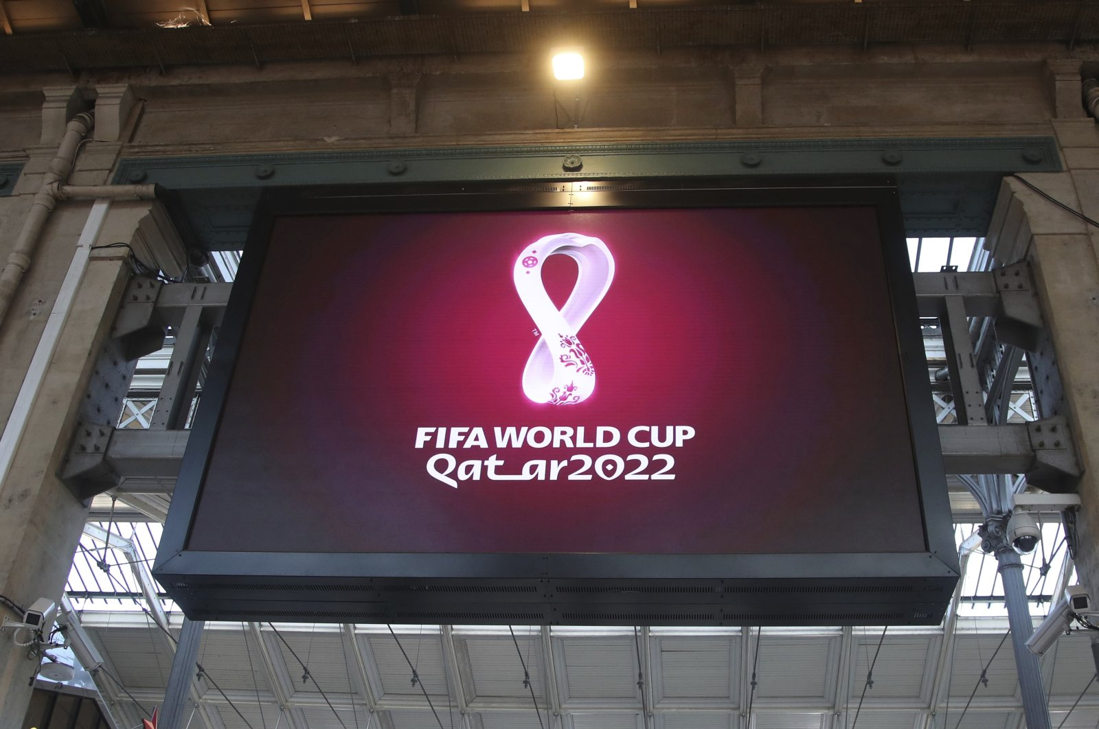 The Qatar 2022 World Cup logo is displayed on a giant screen at the Gare du Nord train station, in Paris, France, Sept. 3, 2019. (AP Photo)