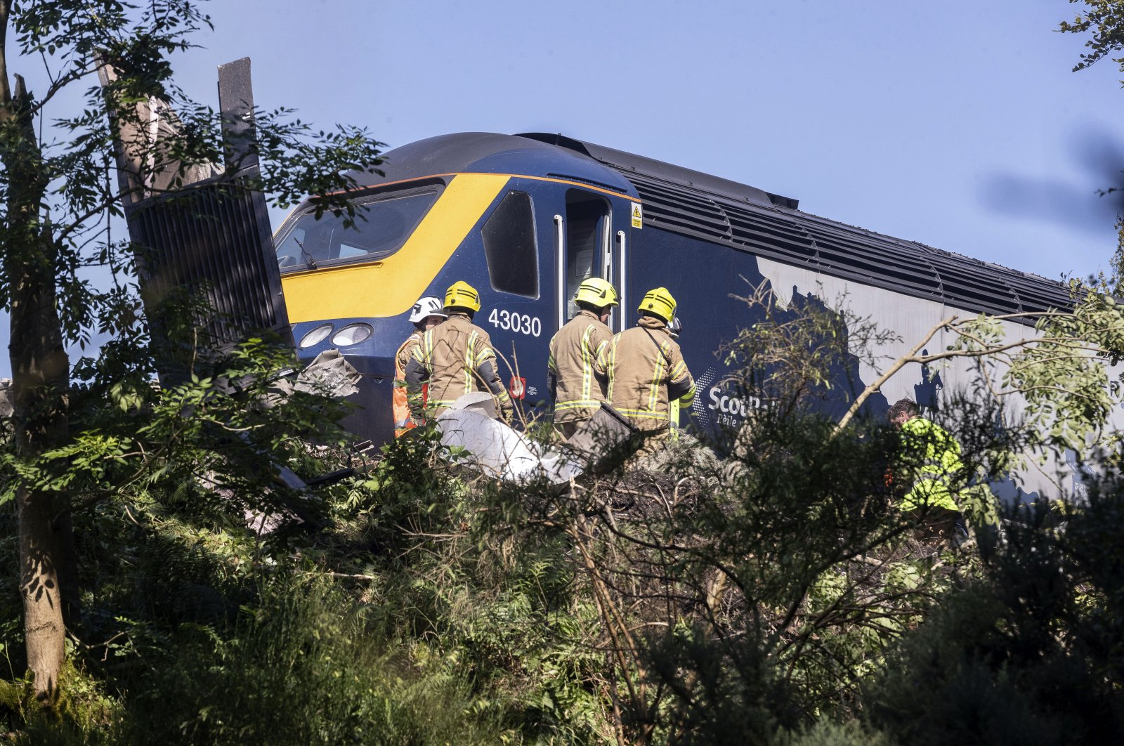 Emergency services attend the scene of a derailed train in Stonehaven, Scotland, Aug. 12, 2020. (AP Photo)