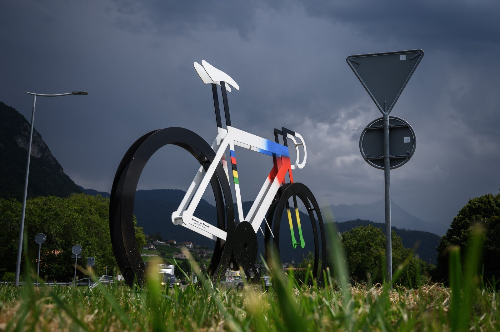 This file photo taken on August 10, 2020 shows a decoration representing a bicycle adorning a round-about in Ollon near Aigle amid the coronavirus crisis and ahead of the 2020 UCI Cycling world championships.  (AFP Photo)