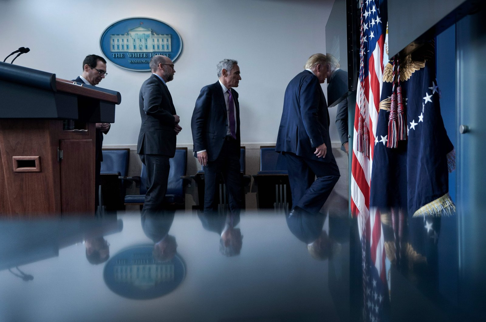U.S. Secretary of the Treasury Steven Mnuchin, Director of the Office of Management and Budget Russell Vought, member of the coronavirus task force Scott Atlas, and U.S. President Donald Trump leave after a briefing at the White House, Aug. 10, 2020, in Washington, D.C. (AFP Photo)
