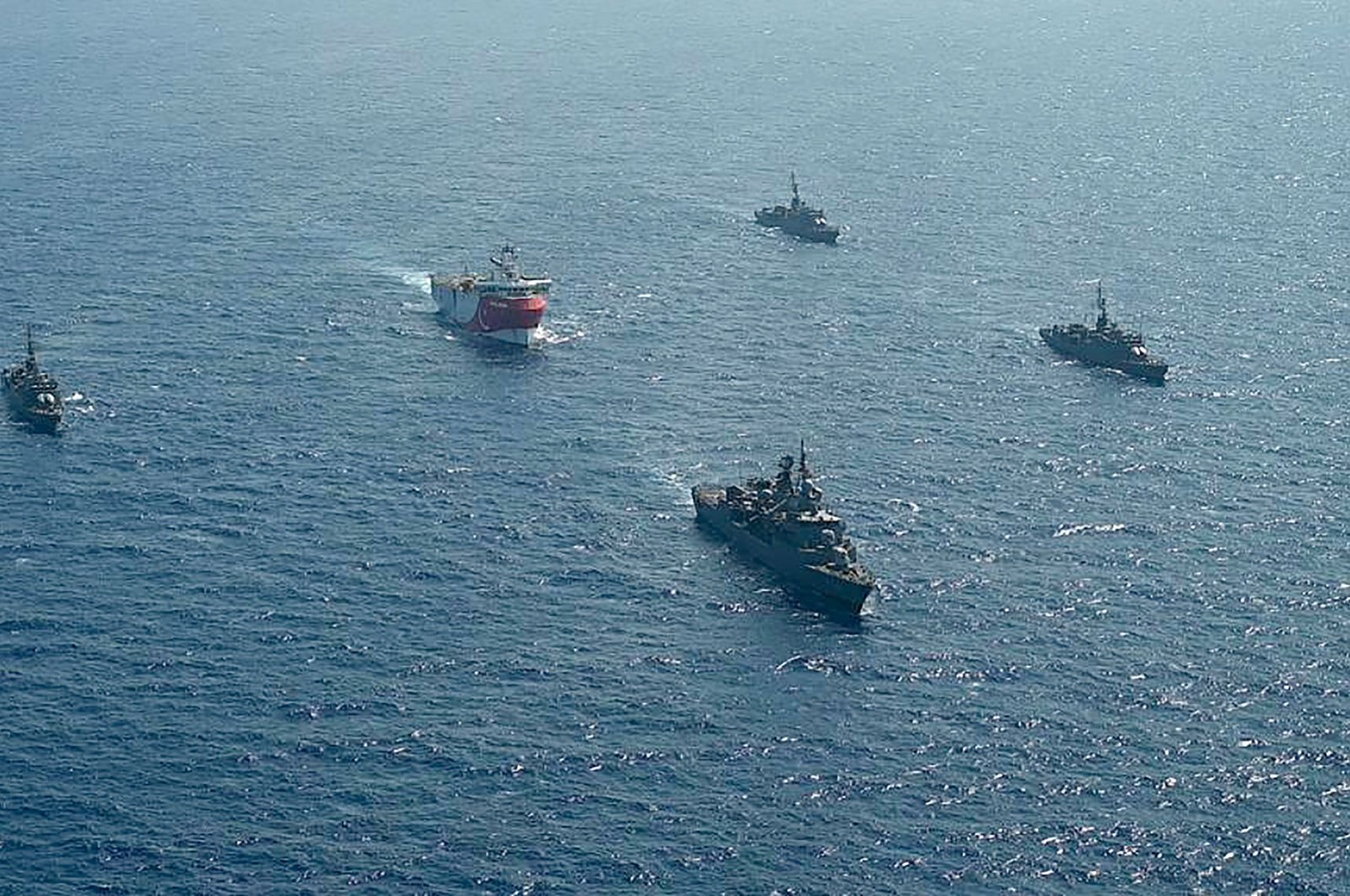 This handout photograph released by the Turkish Defense Ministry shows Turkish seismic research vessel Oruç Reis (C) as it is escorted by Turkish naval ships in the Mediterranean Sea, off southern Antalya province, Aug. 10, 2020. (Turkish Defense Ministry / AFP Photo)